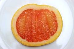 Один одиночный кусок грейпфрута на взгляд сверху Стоковые Фото