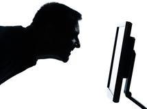 Один силуэт стороны бизнесмена с компьютером Стоковые Фото