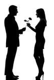 Один человек пар предлагая розовые цветок и женщину Стоковые Фото