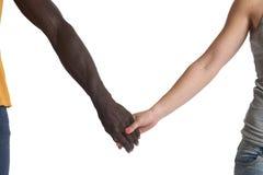Одна кавказская и одна африканская рука на белизне Стоковая Фотография