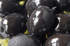 одна черная оливка Стоковые Фото