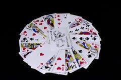 Игральные карты на черной предпосылке стоковые изображения