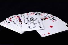Игральные карты на черной предпосылке стоковая фотография