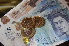 10 5 одно примечание 10 монетки фунта, 5, 1, 5 одно примечание пластмассы полимера примечания монетки фунта Стоковое фото RF