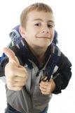 одобренный школьник показывая знак стоковая фотография rf