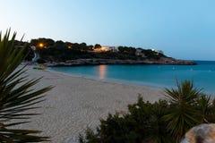 16-ое июня 2017, Felanitx, Испания - взгляд пляжа Cala Marcal на заходе солнца без любых человеков Стоковое фото RF