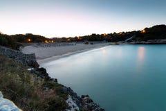 16-ое июня 2017, Felanitx, Испания - взгляд пляжа Cala Marcal на заходе солнца без любых человеков Стоковая Фотография