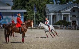 25-ое июля 2015 Церемониальное представление школы верховой езды Кремля на VDNH в Москве Стоковое Изображение