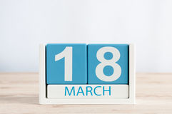 18-ое марта День 18 месяца, ежедневного календаря на предпосылке деревянного стола Время весны, пустой космос для текста Стоковая Фотография RF