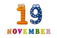 19-ое ноября на белых предпосылке, номерах и письмах Стоковое Изображение