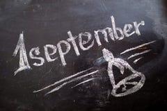 1-ое сентября надпись на классн классном мела Стоковые Фото