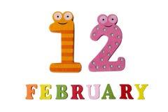 12-ое февраля на белых предпосылке, номерах и письмах Стоковые Фотографии RF