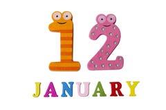 12-ое января на белых предпосылке, номерах и письмах Стоковые Фото