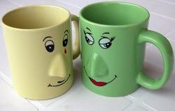оживленные чашки Стоковые Изображения