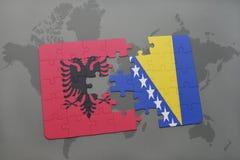 озадачьте с национальным флагом Албании и Босния и Герцеговина на предпосылке карты мира Стоковая Фотография