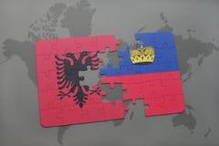 озадачьте с национальным флагом Албании и Лихтенштейна на предпосылке карты мира Стоковые Фото