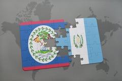 озадачьте с национальным флагом Белиза и Гватемалы на предпосылке карты мира Стоковое фото RF
