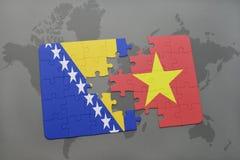 озадачьте с национальным флагом Босния и Герцеговина и Вьетнама на карте мира Стоковая Фотография