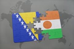 озадачьте с национальным флагом Босния и Герцеговина и Нигера на карте мира Стоковое Фото