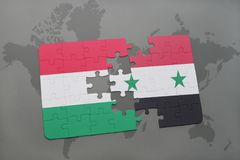 озадачьте с национальным флагом Венгрии и Сирии на карте мира Стоковое Фото