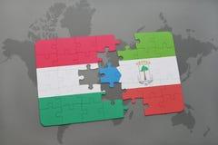 озадачьте с национальным флагом Венгрии и Экваториальной Гвинеи на карте мира Стоковая Фотография RF
