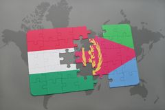 озадачьте с национальным флагом Венгрии и Эритреи на карте мира Стоковая Фотография