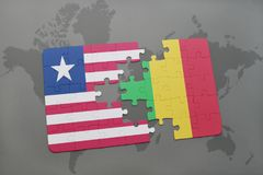 озадачьте с национальным флагом Либерии и Мали на карте мира Стоковое Изображение