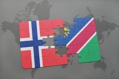 озадачьте с национальным флагом Норвегии и Намибии на карте мира Стоковая Фотография RF