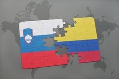 озадачьте с национальным флагом Словении и Колумбии на карте мира Стоковая Фотография