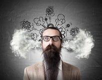 Озадаченный человек с испаряться голова Стоковое Изображение