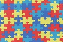 Озадачьте части в предпосылке цветов осведомленности аутизма, renderin 3D Стоковое фото RF