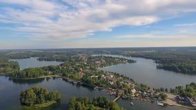 Озера и вегетация на заходе солнца, виде с воздуха Эстонии стоковые фото