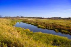Озеро в середине полей Стоковые Изображения