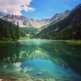 Озеро гор в Alpes Стоковое Фото