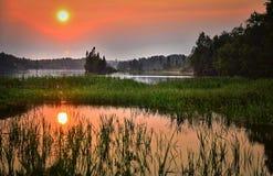 Озеро заход солнца Стоковые Изображения RF