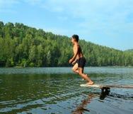 озеро мальчика скача Стоковые Изображения RF