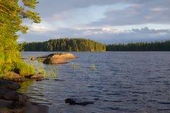 Озеро на заходе солнца Финляндия Стоковая Фотография
