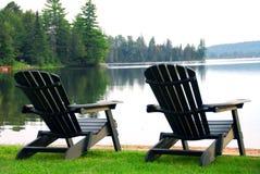 озеро стулов пляжа Стоковые Изображения