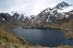 Озеро Херрис, след Routeburn, Новая Зеландия Стоковое Изображение