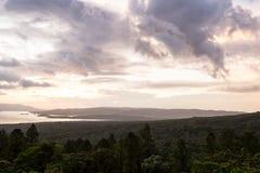 Озеро Arenal на заходе солнца Стоковые Фотографии RF