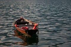 Озеро Como и шлюпка рыболова Стоковое Фото