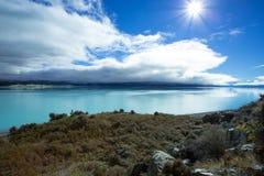Озеро Pukaki на сияющий день Стоковая Фотография RF