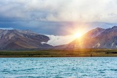 Озеро Tekapo на заходе солнца Стоковая Фотография RF