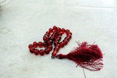 Окаимленный красный розарий Стоковые Изображения