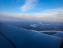 окно восхода солнца самолета Стоковое Фото