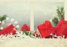 Окно рождества с подарочными коробками Стоковая Фотография