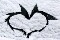 окно сердца снежное Стоковые Изображения RF
