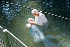 Окрещенный в реке Иордан стоковое изображение