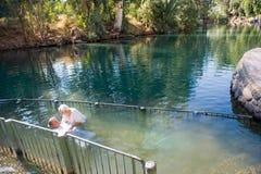 Окрещенный в реке Иордан стоковые фотографии rf