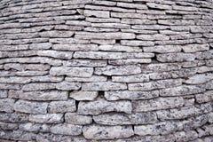 Округленная стена серых камней текстуры, предпосылка стоковое изображение